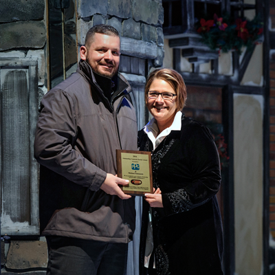 "Michael Patenaude (left), PPG regional sales manager, automotive refinish, accepts the ""Sponsor of the Year"" award from Speedway Children's Charities New Hampshire Chapter Director Cheryl LaPrade."