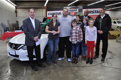 Dean Fisher (left), COO of CARSTAR North, Theresa Workman, husband Dustin, and children Nickolas, Ethan, Caitlyn and Mercedes, with Kevin Norman of Nationwide Insurance and Keven Raines, owner of CARSTAR West Chester.